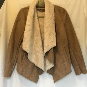 Fur coat, hive and honey